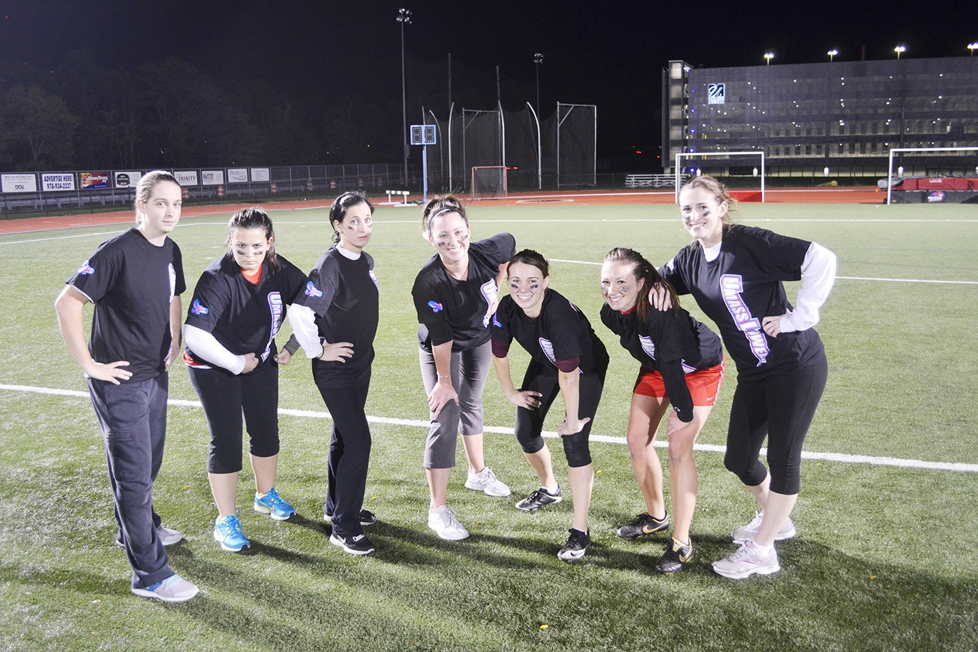 Students posing at Soccer Field At night