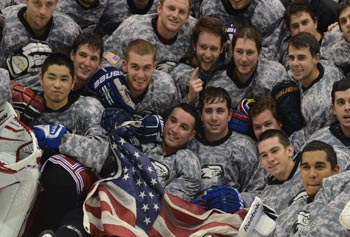A first-place finish was sweet for the UMass Lowell Men's Club Hockey team in its Div. II league. Co-captain Ryan Green, under blue sky of flag, is a senior in meteorology and president of the Student Veterans Organization.