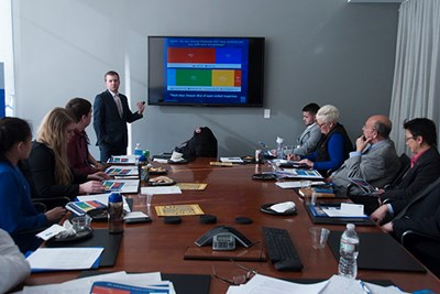 UMass Lowell business major Andre Difilippo presents the results of the December 2017 SGA student survey to the Chancellor's executive team