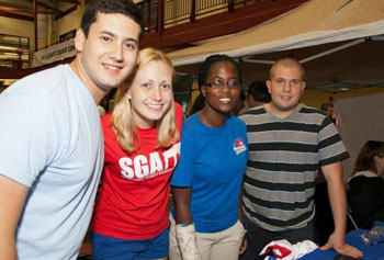 Student Government President Brian Dano, left, and members Tonya Lee Allen, Tamara Vincent and Ben Levesque greeted new students to campus at the recent club fair. Photo by Meghan Moore.