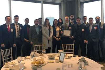 Student Managed Fund members pose at the UMass Club