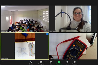 UML physics major Anne Souza teaches an online lab to science teachers in Haiti