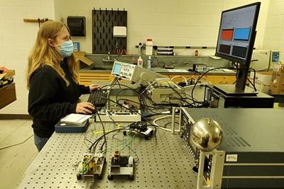 UML honors physics major Michele Woodland analyzes scanning radar signals in Prof. Robert Giles' lab