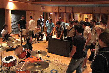 SRT students get some tips on recording drum levels.