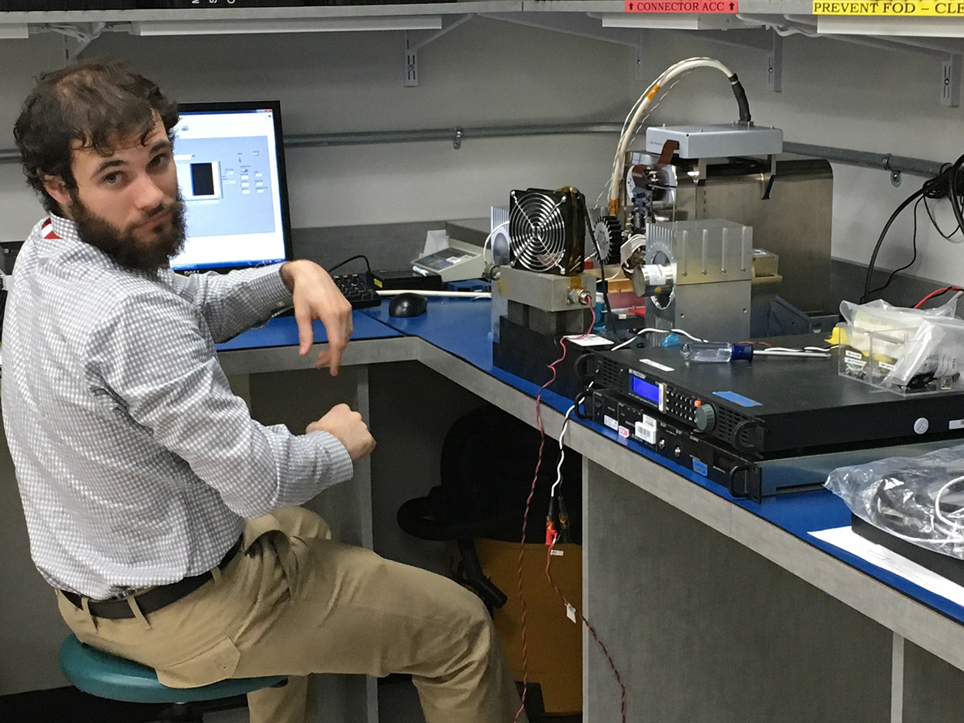 Sam Fingerman, LoCSST staff member, is shown here at BAE Systems testing the control software for the instrument for the MISTIC WINDS project.