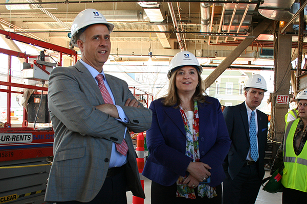 New Manning School of Business Dean Sandra Richtermeyer, center, tours the Pulichino Tong Business Center construction site along with Scott Latham, left.