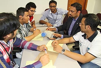 Assoc. Prof. Sukesh Aghara, second from right, demonstrates a handheld radiation detector to nuclear engineering students from Saudi Arabia.
