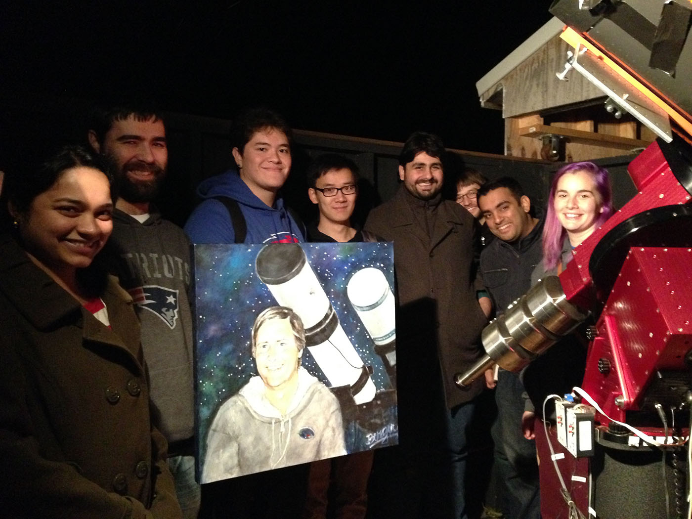 UMass Lowell students at the Schueller observatory (in its original site) holding a portrait of Richard Schueller (painted by a local artist and friend).