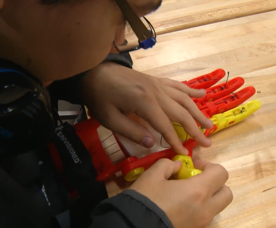 A student works on the creation of a prosthetic hand