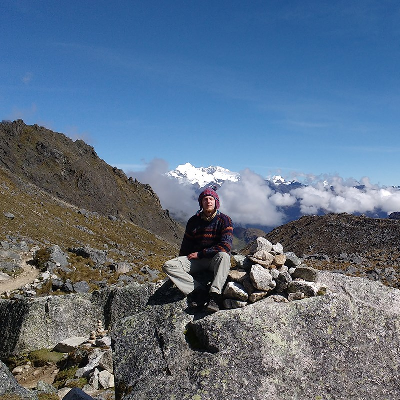 Biology major Sean Cloran poses in front of the Andes