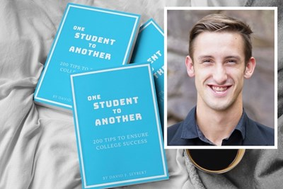 A photo of David Seybert and copies of his book One Student to Another
