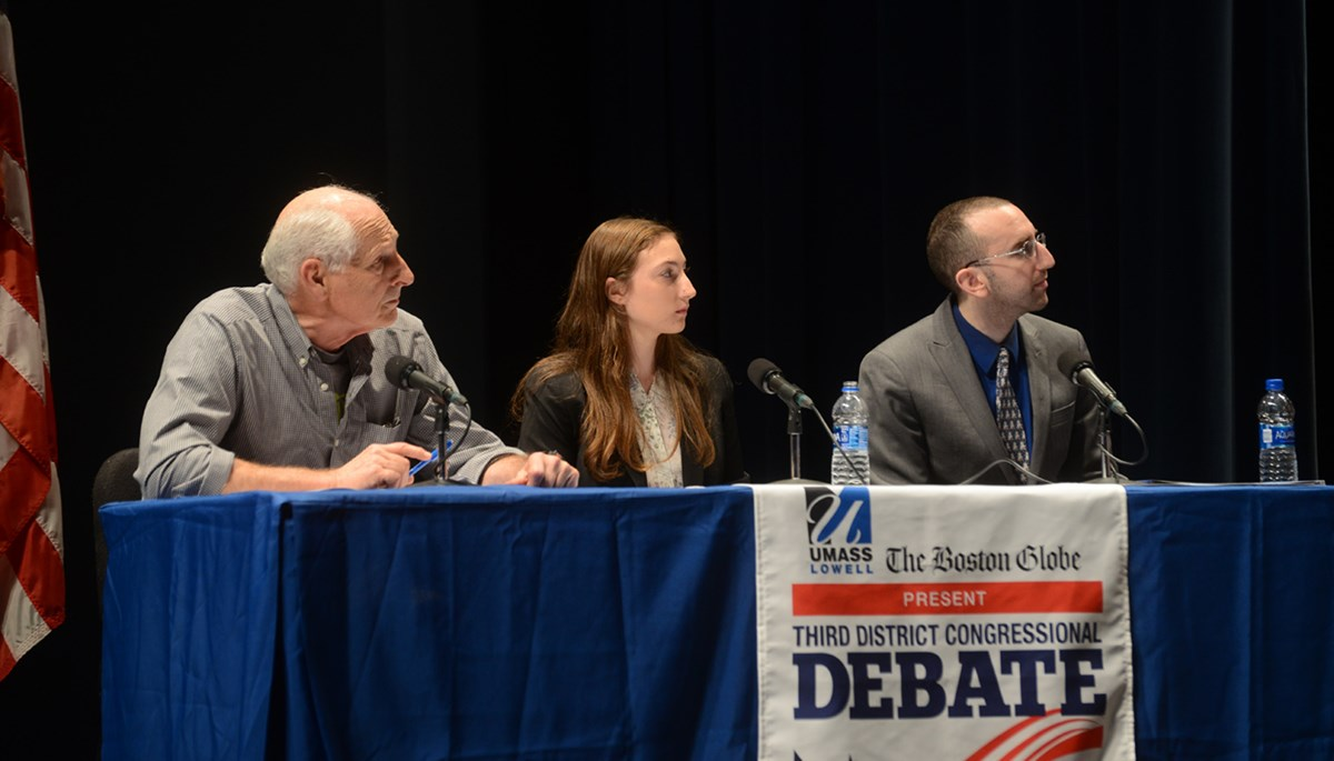 Shaila Bornstein on stage at Durgin Hall as one of the two student panelists for debates among the Democratic primary candidates for Niki Tsongas' seat in Congress