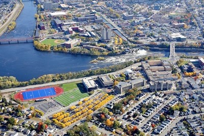 An aerial view of the UML campus and Merrimack River
