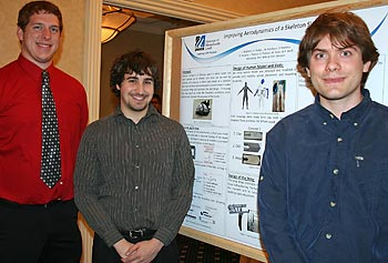 From left, Patrick Mulhern, Richard Poillucci and David Ferber of the UMass Lowell Skeleton Capstone Group present their findings on improving the aerodynamics of a skeleton sled during the 15th annual Student Research & Community Engagement Symposium in April.