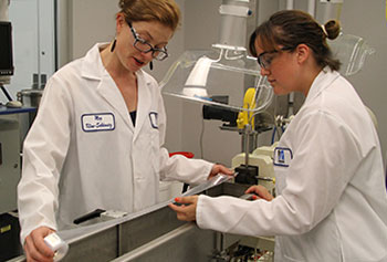 Plastics engineering Asst. Prof. Meg Sobkowicz-Kline, left, with senior student Fran Palacios at the Mark and Elisia Saab Emerging Technologies and Innovation Center.