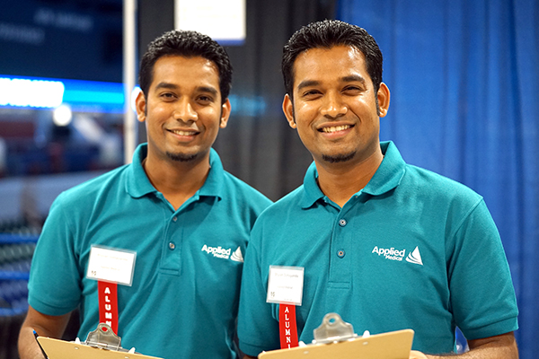 Twin brothers Bhavan (left) and Bhuvan Somayanda, who both earned master's degrees in plastics engineering in 2015, recruited for their company, Applied Medical, at the Career Fair.