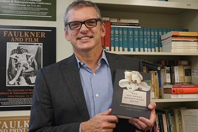 UMass Lowell Prof. Anthony Szczesiul with his new book,
