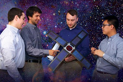 Scientists look at mini-satellite.