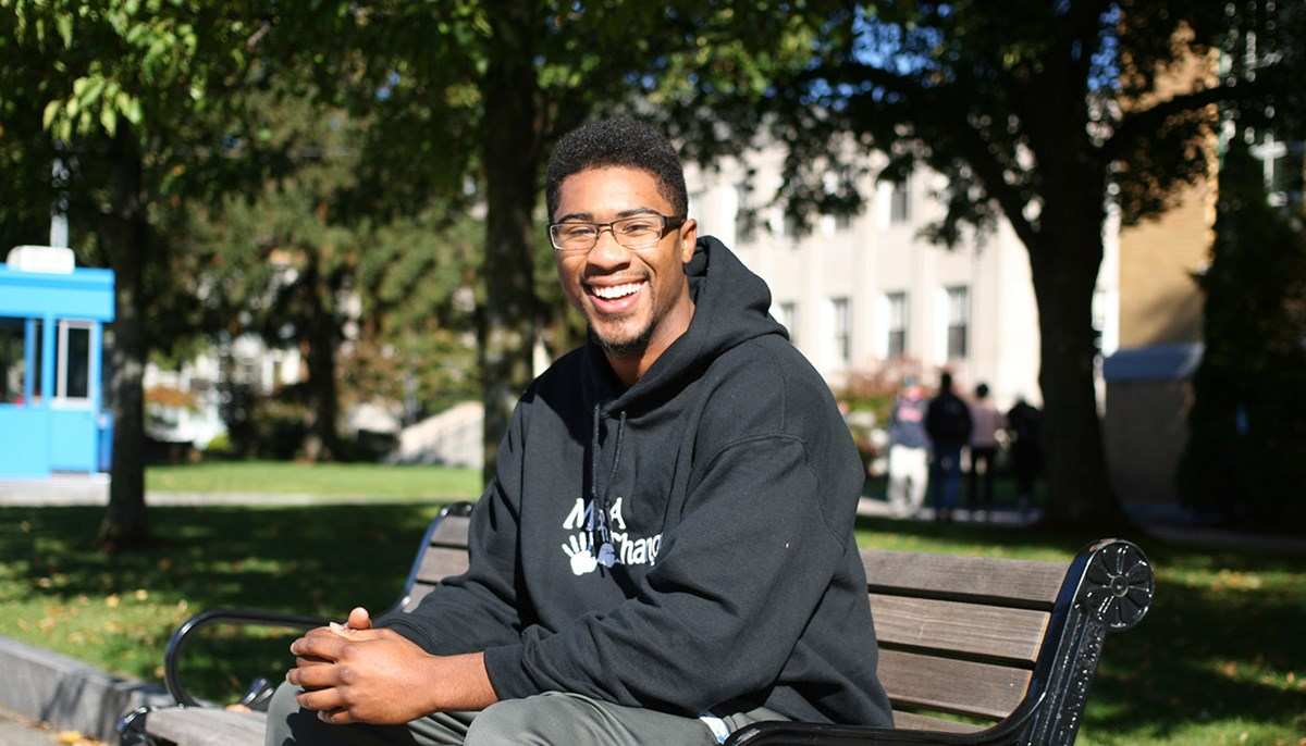 Student Steffan Jackson sitting on a bench on north campus