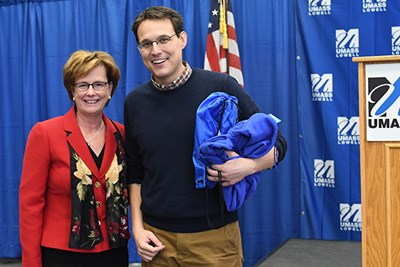 UMass Lowell Chancellor Jacquie Moloney gives MSNBC's Steve Kornacki a sweatshirt
