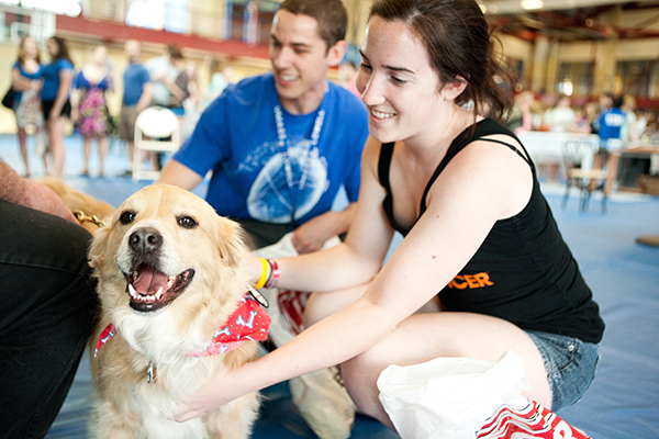 Students pet stress-relief dog at the Campus Rec Center.