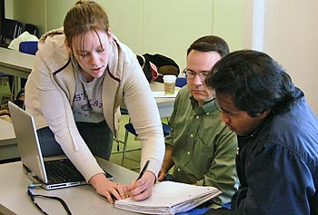 Music majors Maggie Dougherty and Mike McKendry work with computer science major Sophanna Son to figure out the best way to implement a composition program that reflects the way a musician thinks about the problem.