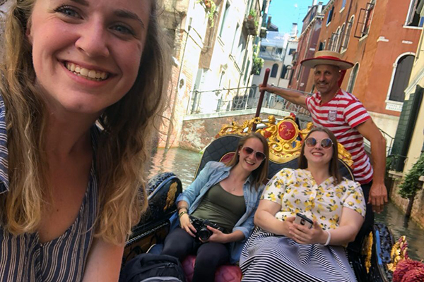 Graphic design major Sarah Georges snaps a selfie with classmates on a gondola in Venice during their studio workshop abroad in Italy in June.