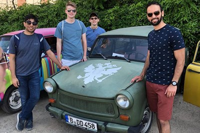 Students pose next to a Trabant car in Germany