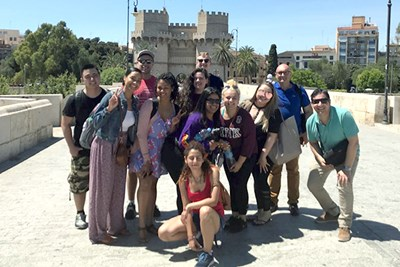 Students pose in front of Torres de Serranos in Valencia, Spain