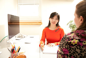Manning School of Business graduate student Summer Zhou says working as a tax prep volunteer gives her the opportunity to help others while getting professional experience.