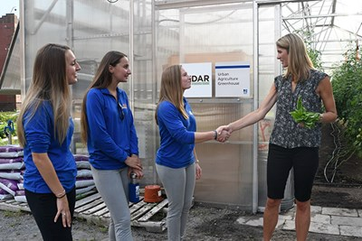 Lori Trahan shakes hands with Sustainability employee Nicole Kelly