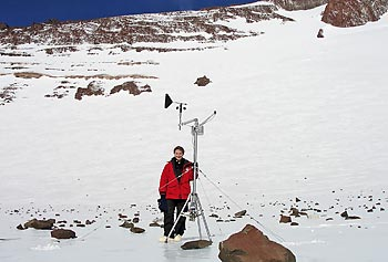 Asst. Prof. Kate Swanger poses next to the meteorological station at Mullins Glacier in Antarctica in this photo by Douglas Kowalewski of UMass Amherst.
