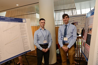 UML math major Paul Fitzmaurice, left, and mechanical engineering major Marinos Blanas at the Student Research Symposium