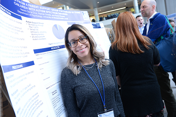 Psychology major Naomi de la Cruz at UML's Student Research & Community Engagement Symposium