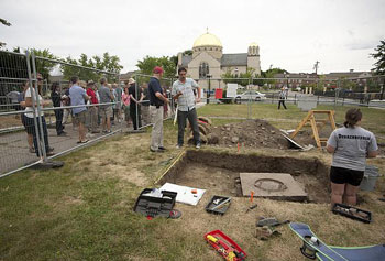 Teachers from across the country got to learn about Lowell history during a visit to an archaeological excavation at St. Patrick's Church.