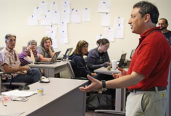 Twenty undergraduate educators from across the county participated in a workshop hosted by UMass Lowell's Computer Science Department on developing apps for mobile devices and how to incorporate the technology into their coursework. Speaking to the attendees, at right, is Assoc. Prof. Fred Martin.