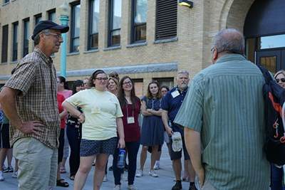 Lowell historians Gray Fitzsimons and David McKean take teachers on a walking tour of the Acre neighborhood as part of a National Endowment for the Humanities summer teacher institute