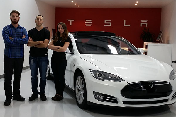 Engineering grad Kevin Newland, left, and seniors David Cacciola and Amy Tibbetts are using their internships at Tesla Motors to boost their careers.