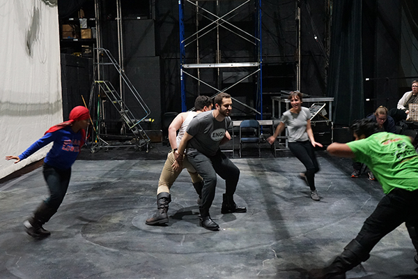 "Nick Abourizk, center, played the title role in ""Macbeth"" while interning in publicity and marketing for the show. Here, he and Banquo (Fernando Barbosa) rehearse a scene with the witches."