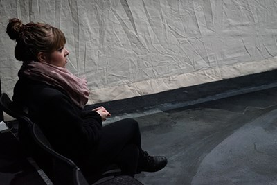 "Technical theatre intern Rachael Bergeron watches intently from the sidelines during a rehearsal of ""Macbeth"" at UMass Lowell"