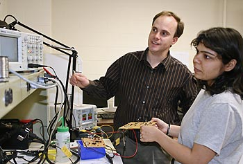 Assoc. Prof. Joel Therrien works with a student in the lab.
