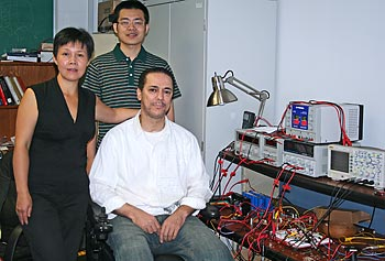 Assoc. Prof. Tingshu Hu with her graduate students Haifeng Wang, center, and Khalid Kanane.