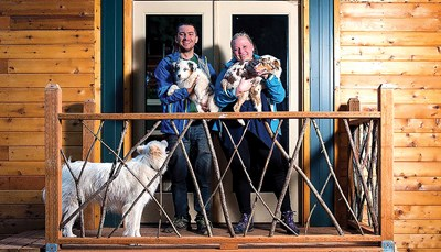 Tiny house owners Luke and Tiny Orlando and their three dogs