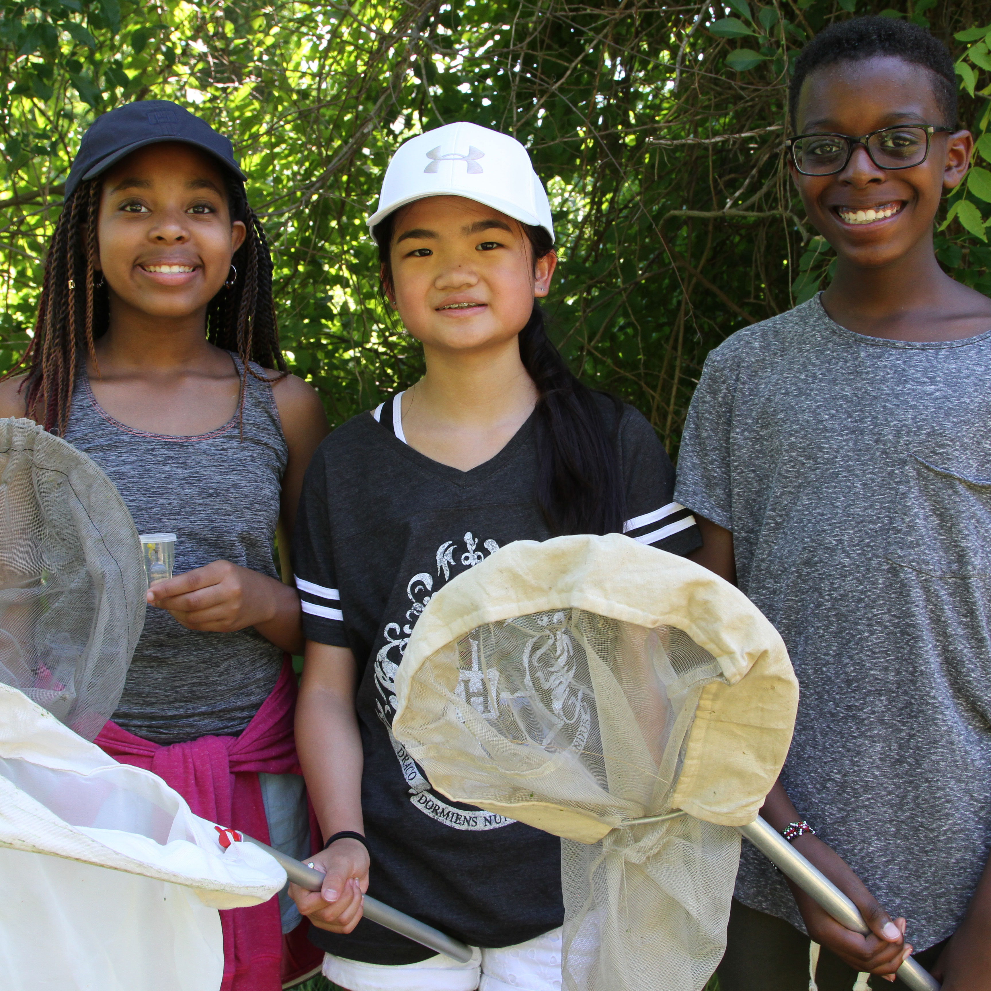 School-age kids holding nets on a field trip with the Tsongas Industrial History Center