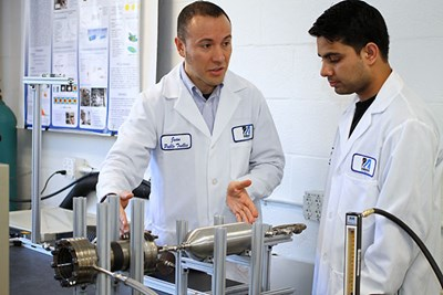 Asst. Prof. Trelles and his student in the lab