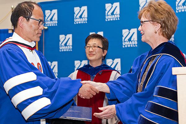 Chancellor Jacquie Moloney, right, awards Prof. Shuji Nakamura an honorary doctor of humane letters degree from UMass Lowell as Vice Chancellor for Research & Innovation Julie Chen looks on.