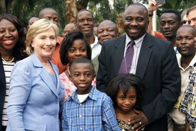 The Tsewole family pose with Hillary Clinton in the Congo