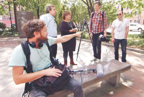A UK Travel Channel video crew visited Lowell on Thursday in Kerouac Park. From left are UK Travel Channel's Ian Hart, Kerouac expert Paul Marion, Greater Merrimack Valley Convention & Visitors Bureau President Deb Belanger, director Justin Hawkes and host Julian Hanton.