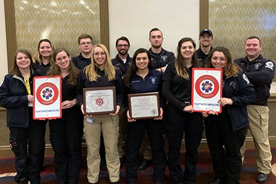 Student EMTs hold their awards at the NCEMSF conference