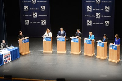 Candidates stand on the Durgin Hall stage during the second debate